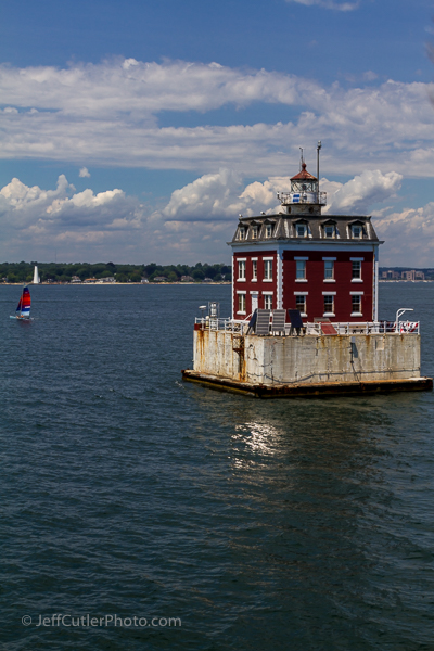 New London Ledge Light with a sailboat and New London Harbor Light in the background.