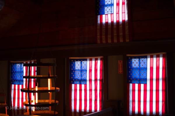 Flags adorn the windows inside Vine Brook Tavern.